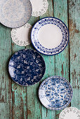 Blue-and-white plates and doilies