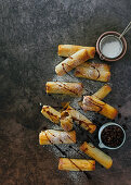 Filo-wrapped bar one 'cigars' with coffee syrup