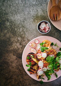 Chargrilled guavas with radishes, peanuts, chilli and herbs