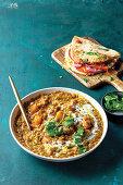 Curried lentil and pumpkin soup with nann-sandwiches
