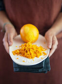 Orange and orange zest for an orange cake