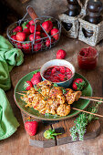 Chicken skewers with strawberry sauce