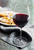 Glass of red wine and roast veal