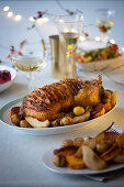Duck wrapped in bacon filled with apples, pears and chestnuts