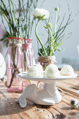 White coconut biscuits on cake stand with rabbit-shaped base