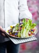 Man serving Persian salad