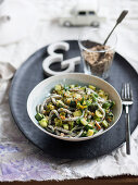 Dark whole grain pasta with zucchini and nut parmesan