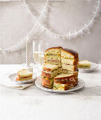 Spicy Panettone sandwich cake with mushrooms, Roquefort, smoked fish and mango