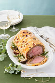 Roast beef with mushrooms wrapped in pastry