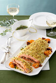 Salmon with a couscous and almond crust, kumquats and figs