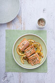 Roasted salmon fillet with oranges, pine nuts and parsley
