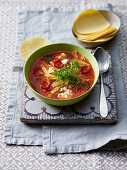 Tortilla and tomato soup with feta cheese