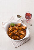 Pork ribs in a red wine and cinnamon sauce