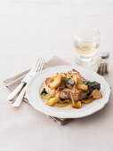 Oven-roasted pork chops with apples and onions