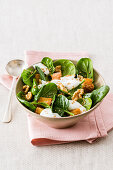 Baby spinach salad with walnuts, sesame and yoghurt feta sauce