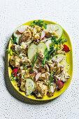 Cauliflower salad with green apples and radish