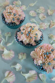 Carnations and silver balls in muffin cases decorating table