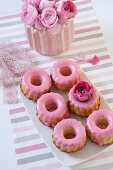 Pastries with pink icing and ranunculus