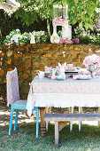 Vintage-style Easter table in set lilac and mint green in garden