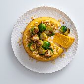 Pumpkin and almonds flan with Brussels sprouts