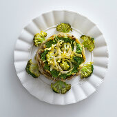 A charlotte made of caramelised chicory and bean broccoli cream