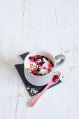 A mug muffin with oatmeal and berries