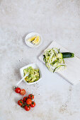 Ingredients for zoodles with avocado and tomatoes