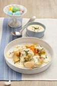 Steamed vegetables with cheese sauce and dill