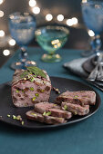 Duck terrine with raisins and pistachios