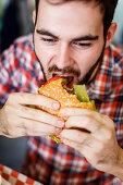 Man eating juicy lucy burger