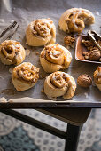 Vegan apple and walnut snails with icing.
