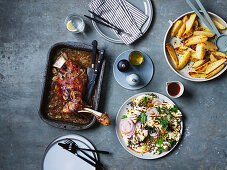 Greek slow-cooked lamb shoulder with 40 cloves of garlic, fakes salad, barbecued cauliflower and tahini yoghurt