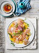 Kingfish with radish, watercress, Campari dressing and Bottarga