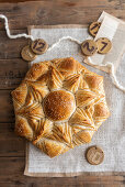 A star-shaped Advent bread with sesame seeds