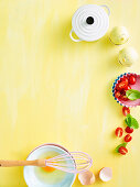 Eggs, tomatoes, bowl in kids kitchen