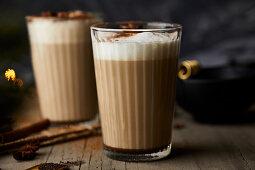 Chai latte in glasses with milk foam