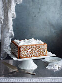 Fruit cake with gingerbread collar and baiser