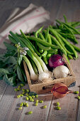 An arrangement of vegetables with onions and beans