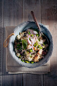 Bread salad with red onions and fava beans