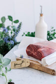 Beef on a wooden chopping board