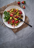 Brussels sprouts with crispy tofu, strawberries and toasted walnuts