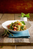 Fregola with asparagus, peppermint and fried capers