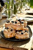 Doughssants with lemon glaze, blueberries and almonds