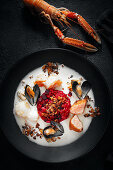 Beetroot risotto with seafood, stollen topping and ginger sauce