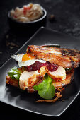 A stollen burger with poultry breast, quail egg and cranberry mustard