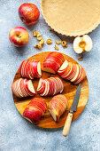 Preparation of an apple tart: Sliced apples on a wooden board