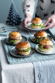 Mini burgers with cotechino, herb cream and endive