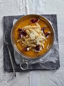 Capunsei con crema di zucca (Grana Padano dumplings on pumpkin cream, Italy)