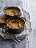 Autumn pumpkin grana padano soup with rye bread