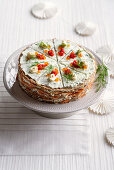 Crepe cake with smoked salmon and salmon caviar